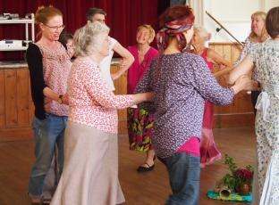 Circle dancing with Karoline.